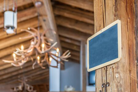 Empty chalk board hung in a mountain hut in Valle Aurina, South Tyrol, Italy Stock Photo