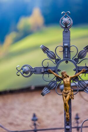 Cross in the cemetery of St. Veit in the Pragser valley, South Tyrol, Italy