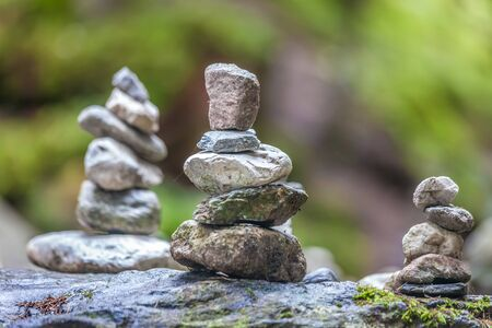 Balancing cairns in the forest in South Tyrol, Italy Standard-Bild