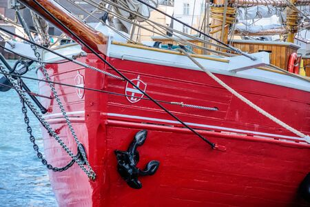 Red bow of an old sailing ship in Amaliehaven, Copenhagen, Denmark