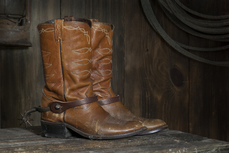 barn boots: cowboy boots in the barn