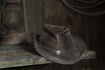 period costume: cowboy hat on a shelf in the barn