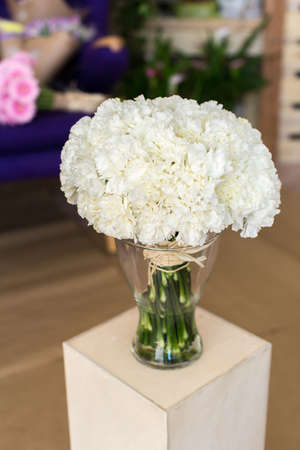 glass vase: Bouquet of carnation flowers in glass vase Stock Photo