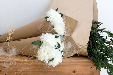 cornet: Two bouquets of white chrysanthemums in a paper cornet Stock Photo