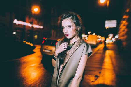 gorgeous girl: Sexy gorgeous brunette girl portrait in night city lights. Motion effect.