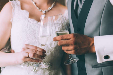 wedlock: Bride and groom holding champagne glasses Stock Photo