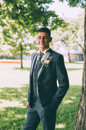plastron: Handsome groom at wedding tuxedo smiling and waiting for bride. Happy smiling groom newlywed