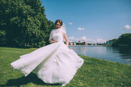 Beautiful Young Bride In A Magnificent Wedding Dress Spinning ...