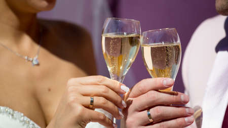 sparkling wine: Couple, man and woman, drinking champagne in a fine dining restaurant, each with glass of sparkling wine Stock Photo