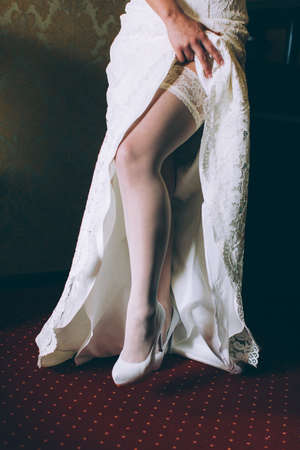 dowry: Hem of her dress. Bride shoes. Lace train wedding dress.
