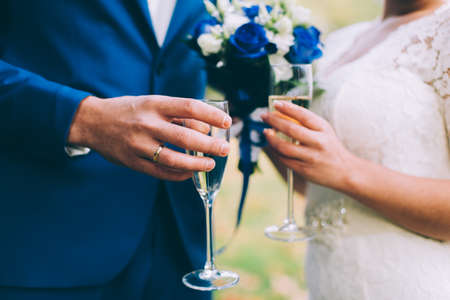 clinking: Newlyweds clinking glasses