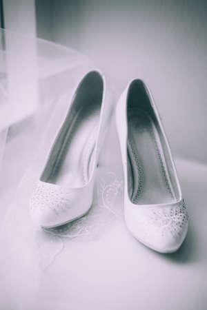 foot gear: brides white shoes Stock Photo