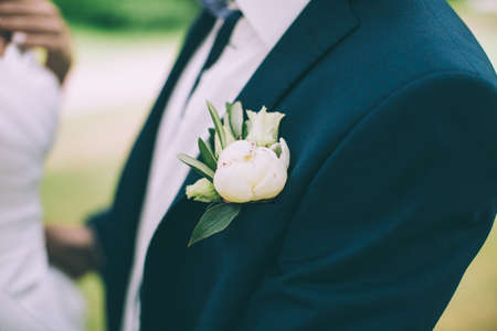 boutonniere: wedding boutonniere on suit of groom Stock Photo