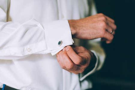 cufflink: Wedding details, cufflinks, elegant male suit and hands