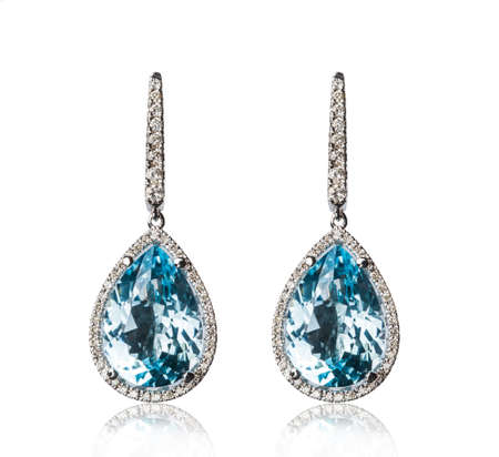diamond jewelry: Pair of diamond earrings, isolated on white