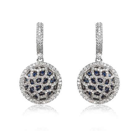 diamond earrings: Pair of diamond earrings, isolated on white