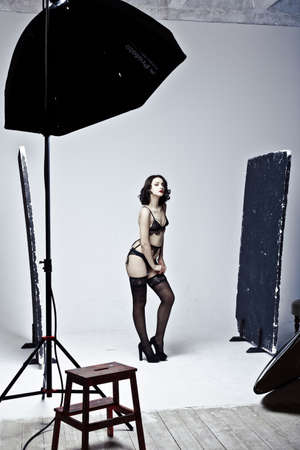 backstage: Beautiful lingerie model posing in studio photography. Backstage