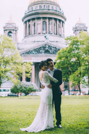 Bride and groom on the background of St. Isaacs Cathedral