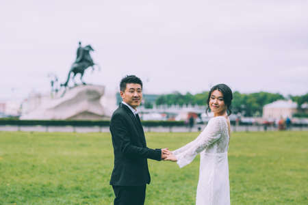 horseman: Bride and groom on the background of the Bronze Horseman Stock Photo