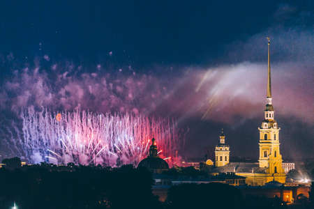 Fireworks over the city of St. Petersburg (Russia) on the feast of Scarlet Sails, in the rain with fog and smoke.