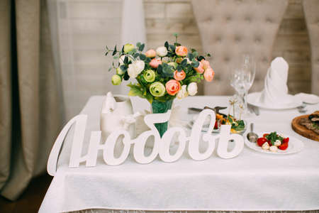 formal dinner party: Table setting at a luxury wedding reception. Stock Photo