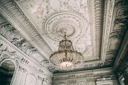 Chandelier and ceiling in an old abandoned palace Stock Photo