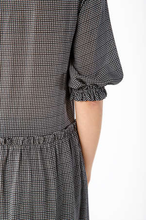 Details of womens clothing. Detail dress on a model on a white background