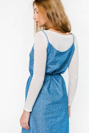 Young elegant female in light summer dress, over white background Stock Photo