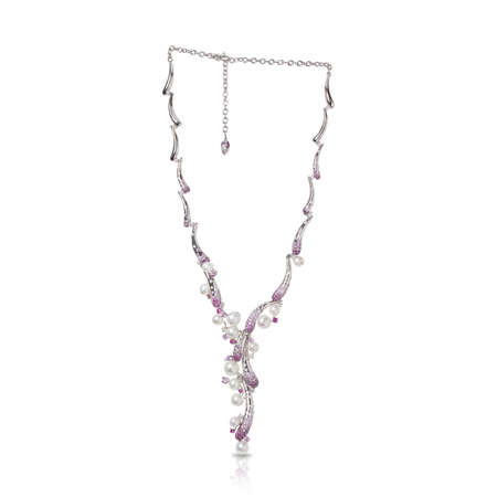 White gold necklace with diamonds, pink sapphires and pearls isolated on a white background