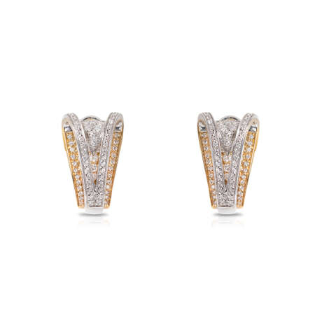Spectacular earrings in white and yellow gold with diamonds isolated on a white background