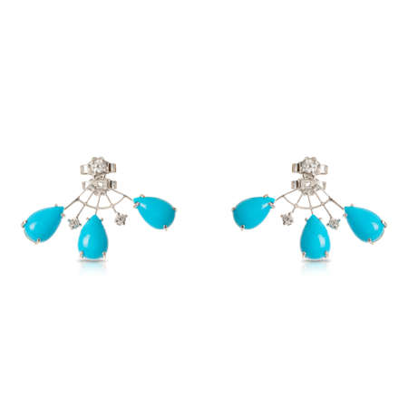White gold fan stud earrings with diamonds and turquoise isolated on a white background