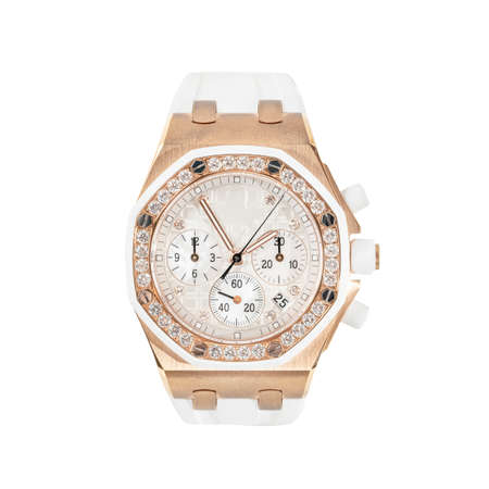 Rose gold chronograph watch with rubber strap, front view on a white background