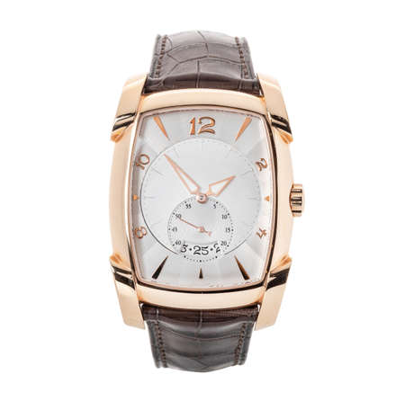Luxury rose gold watch isolated on white. Classic watch with an annual calendar and a smooth bezel. Front view automatic wristwatch with brown leather strap
