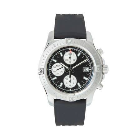 Luxury steel watch with a black rubber strap, front view on a white background