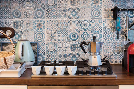 Coffee geyser heats a kettle on a home boiling water gas stove Zdjęcie Seryjne