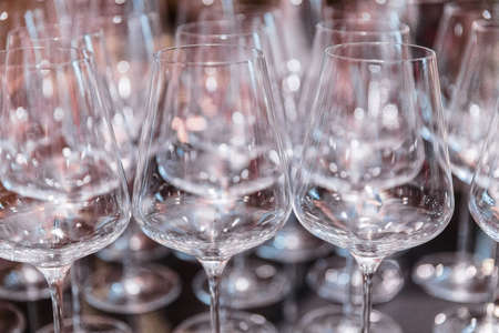 Plenty of empty clean wine glasses on the table during a banquet