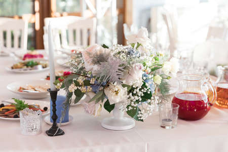 Table set for holiday, event, party or wedding reception in indoor restaurant