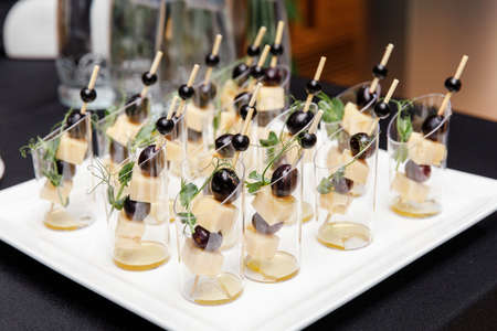 Set of canapes of cheese, olive and honey stand on the buffet table Stockfoto