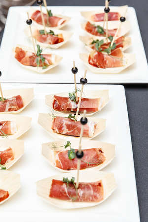 Set of jamon canapes stands on a buffet table Stockfoto