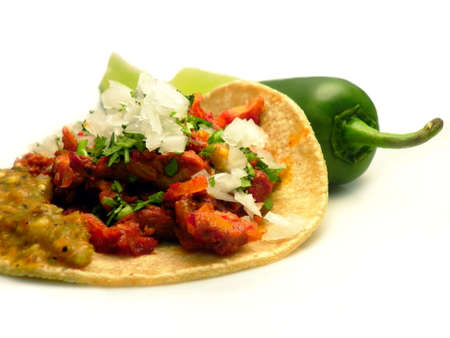 jalapeno pepper: Taco al pastor with onion and chili sauce, accompanied by a jalapeno pepper