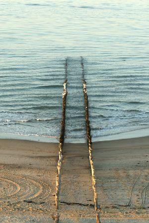 dividing: Breakwater dividing land and sea