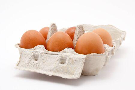 brown organic eggs in a box