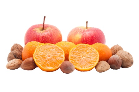 red apples, mandarins  with waterdrops and nuts isolated on white background photo