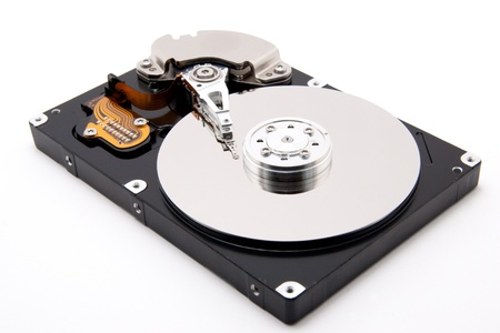 harddrive: defective open harddrive with write read head on white background