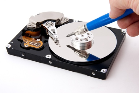 defective: repair service open defective computer hard drive with screw driver Stock Photo