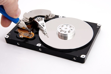 repair service open defective computer hard drive with screw driver Stock Photo