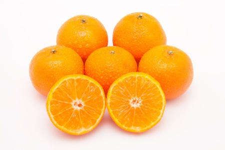 tasty juicy mandarines on white background with waterdrops