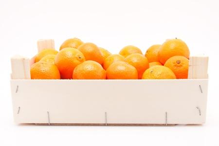 wodden box full of mandarines on white background Stock Photo