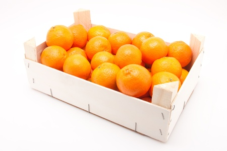wodden box full of mandarines on white background photo