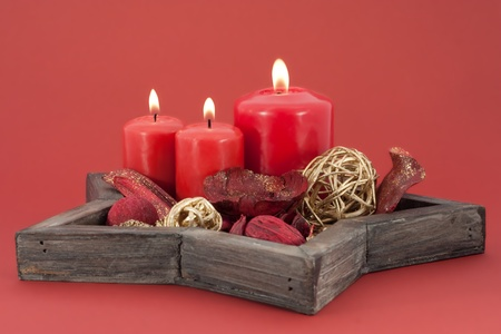 seasonal objects star shaped dish with red candles and christmas decoration photo